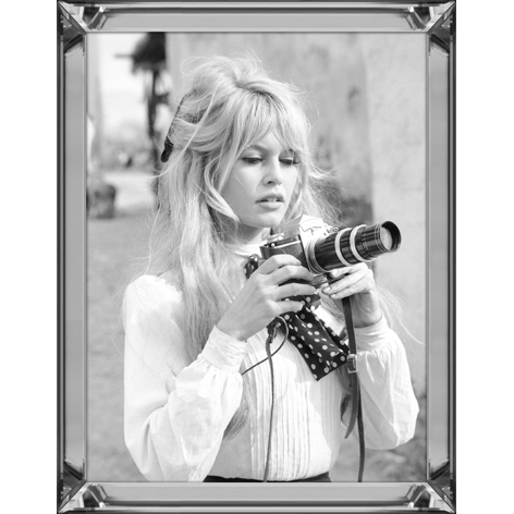 Bardot holds camera